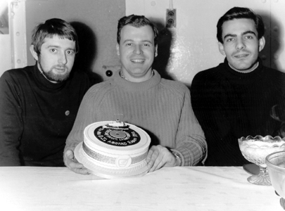 Stephen West, Edward Cole and Paul Beresford with a cake